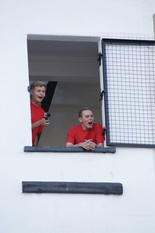 Fire Cadets looking down from a window
