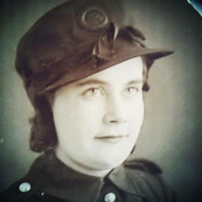 Black and white photograph of Firefighter Maisie Beth Spooner in her uniform