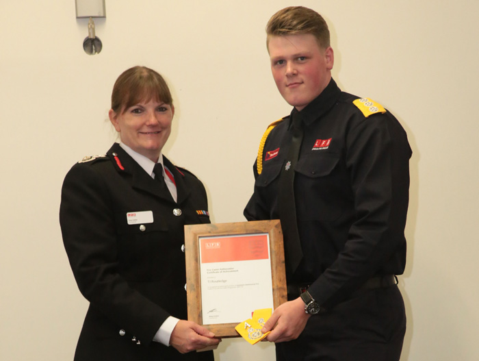 Dany Cotton giving a cadet his certificate