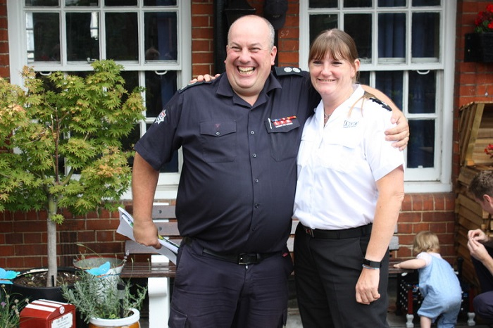 Green Watch Manager, Mat Rosendale and London Fire Commissioner Dany Cotton smiling with their arms around each others shoulders