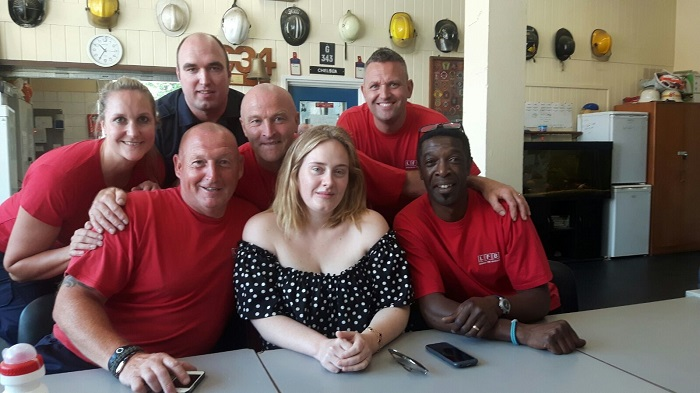 Singer, Adele sat with firefighters from Chelsea fire station