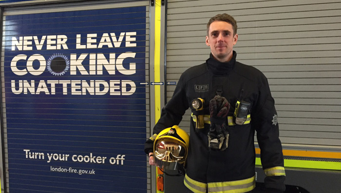 Firefighter, Mat Riley who appeared on The Great British Bake Off stood by a fire engine