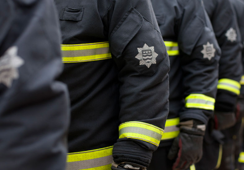 Close up of LFB Firefighter badge