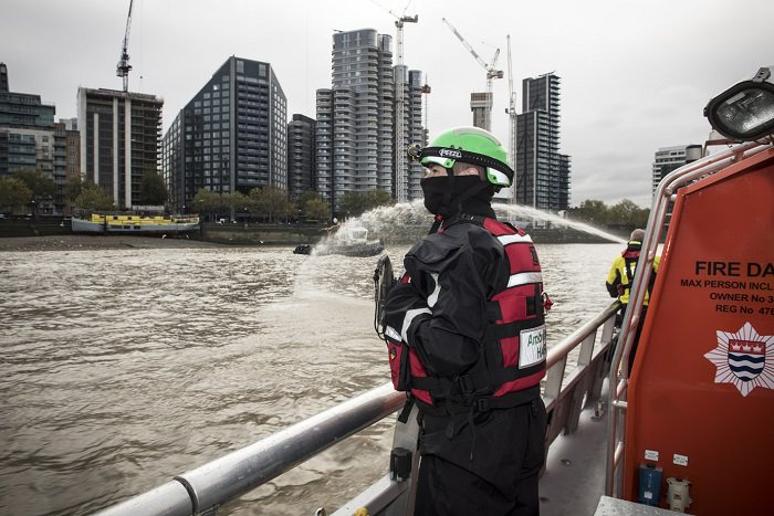 Firefighters on a boat on the river  Thames