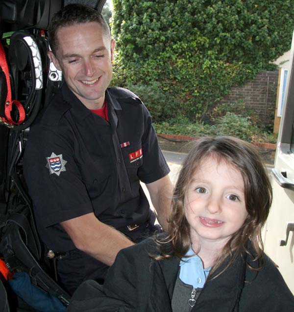 Poppy, the little girl that was saved in the cab of a fire engine with one of the firefighters that helped save her