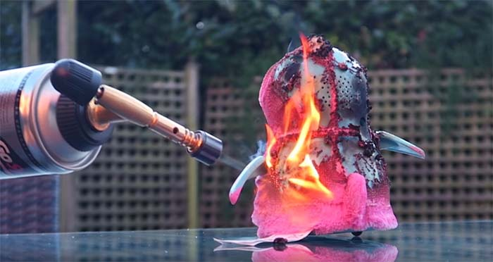Youtuber burning toy with blowtorch