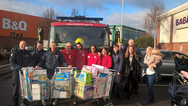 Firefighters buying Christmas presents for the Children's ward at King George Hospital