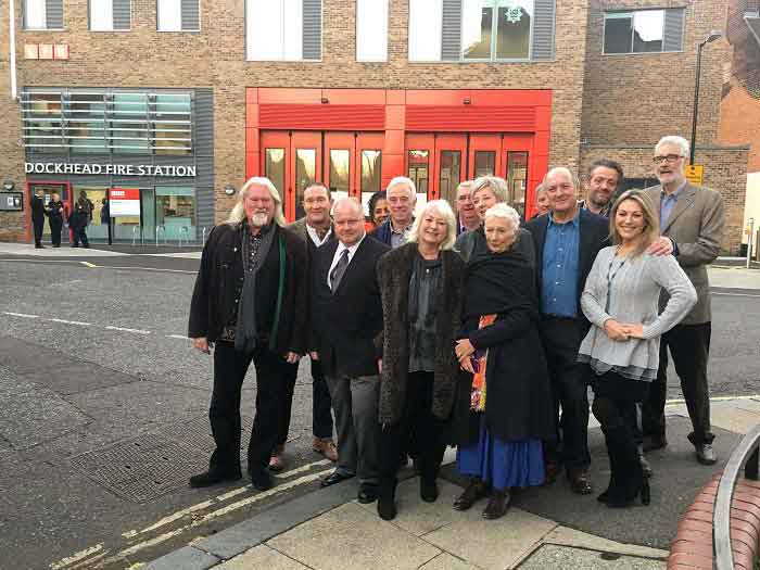 London's Burning cast standing in front of the new Dockhead Fire station