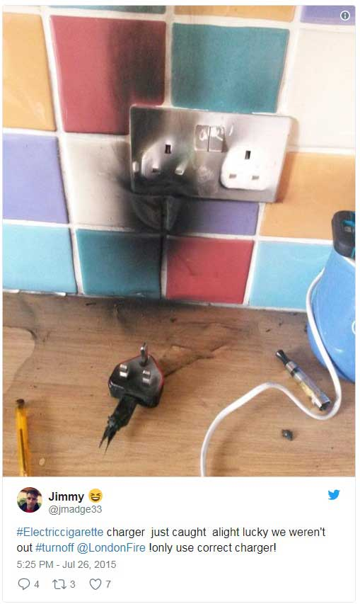Screenshot of a tweet of a faulty charger that has exploded and burnt the plug socket