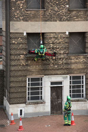 Firefighter training, scaling down a building