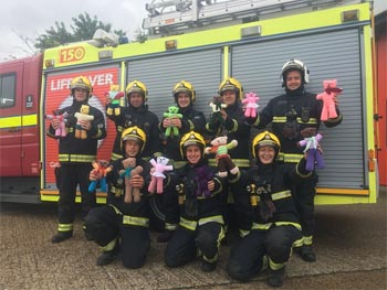 Firefighters from Hillingdon holding up the trauma bears