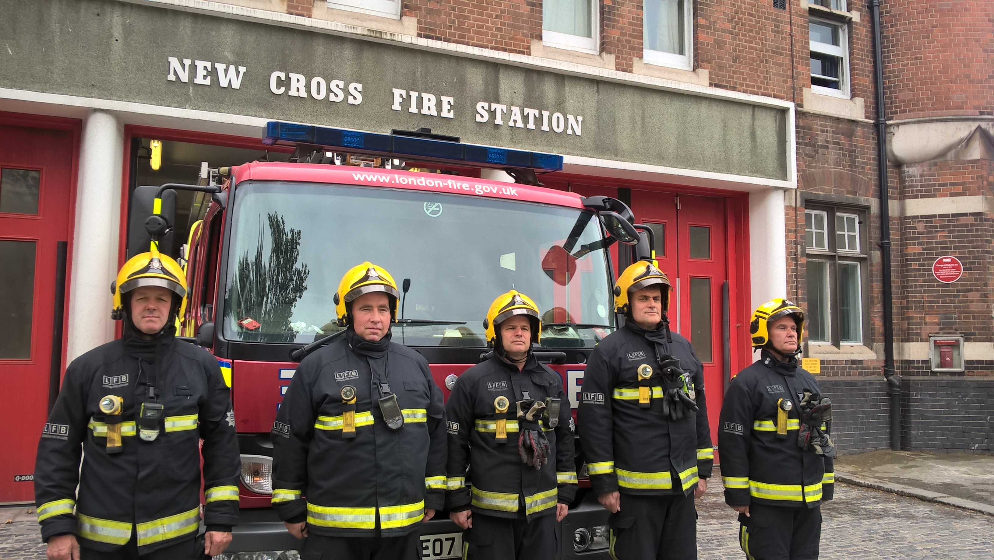 Firefighters outside New Cross fire station