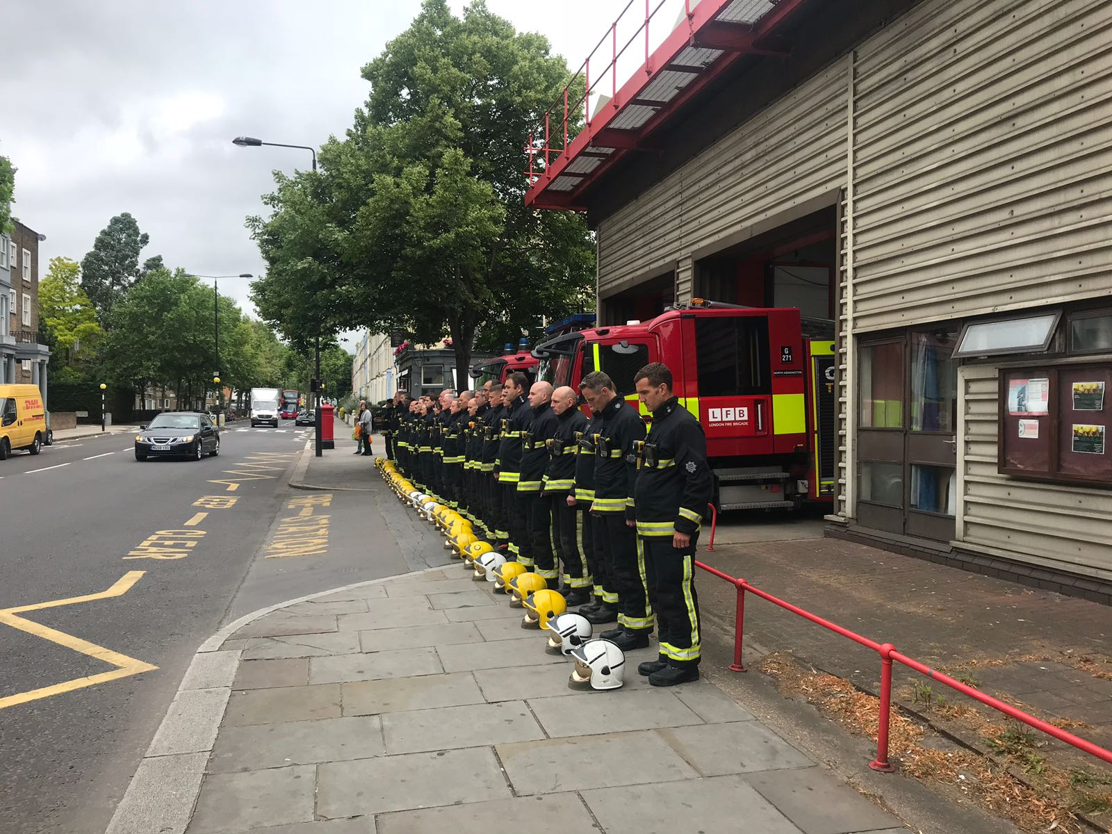Firefighters outside North Kensington fire station