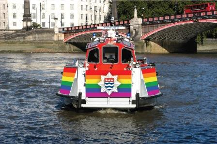 London Fire Brigade fire boat wrapped in the rainbow flag for Pride 2018