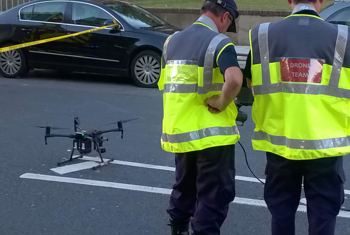 Drone operators getting ready to launch a drone at an incident in London.