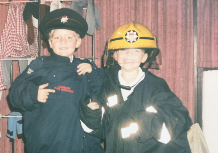Tom (L) and Jack (R) as children wearing firefighters uniform